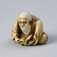 Netsuke Depicting an Old Man Reading a Book